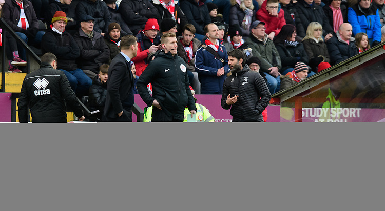 Grimsby Town manager Michael Jolley, left, and Lincoln City manager Danny Cowley speak to fourth official Scott Oldham<br /> <br /> Photographer Chris Vaughan/CameraSport<br /> <br /> The EFL Sky Bet League Two - Lincoln City v Grimsby Town - Saturday 19 January 2019 - Sincil Bank - Lincoln<br /> <br /> World Copyright &copy; 2019 CameraSport. All rights reserved. 43 Linden Ave. Countesthorpe. Leicester. England. LE8 5PG - Tel: +44 (0) 116 277 4147 - admin@camerasport.com - www.camerasport.com