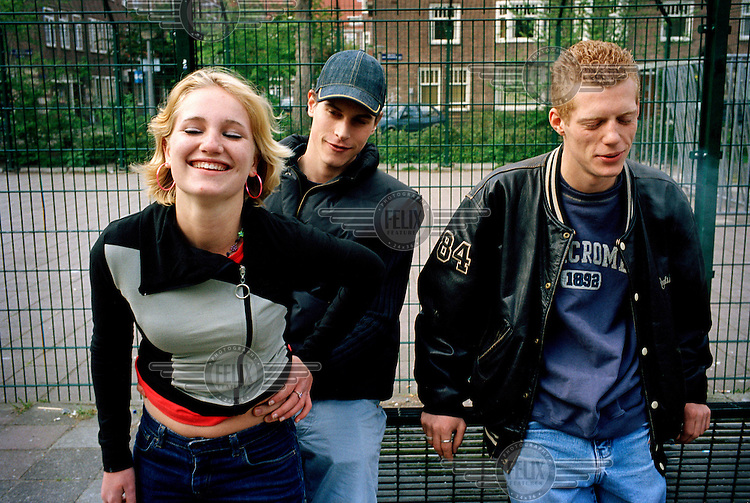 Dutch teenager Sophie de Ruiter (16) socialises at a basketball court with her boyfriend Laurens (19) and their friend Niels (right).  She lived with her Jewish mother after her parents divorced when she was one year old.  Having run away from home at the age of fourteen, she has moved into a house run by the '16+' supervised housing project.