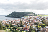 PORTUGAL, The Azores, Terceira Island, view of Angra do Heroismo city and Monte Brasil in the background