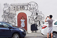 Malaysia, Penang. Old Georgetown Streets - a UNESCO World Heritage site. Funny mural installations.