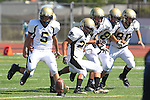 Torrance, CA 09/08/11 - Max MacLeay (Peninsula #5), Carlo Merola (Peninsula #80), Jake Teren (Peninsula #85), Issac Kuo (Peninsula #28) and Shane Scott (Peninsula #18) in action during the North-Peninsula Junior Varsity Football game at North High School in Torrance.
