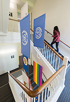 International flags hang along a staircase in Johnson Hall, Occidental College, April 16, 2014. (Photo by Marc Campos, Occidental College Photographer)