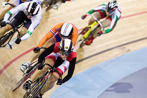 19 FEB 2012 - LONDON, GBR - Canada's Monique Sullivan (CAN) (centre in black and red) leads the field during her Women's Keirin first round race at the UCI Track Cycling World Cup, and London Prepares test event for the 2012 Olympic Games, in the Olympic Park Velodrome in Stratford, London, Great Britain .(PHOTO (C) 2012 NIGEL FARROW)
