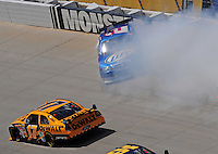 Sept. 21, 2008; Dover, DE, USA; Nascar Sprint Cup Series driver Matt Kenseth (17) goeslow to avoid a spinning Kurt Busch (2) during the Camping World RV 400 at Dover International Speedway. Mandatory Credit: Mark J. Rebilas-