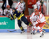 Justin Bonitatibus (Merrimack - 17), Joe Pereira (BU - 6), Vinny Saponari (BU - 27) - The Boston University Terriers defeated the Merrimack College Warriors 6-4 (EN) on Saturday, January 16, 2010, at Agganis Arena in Boston, Massachusetts.