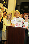 Fan Joan Ackerman and fans pose with Guiding Light's Tina Sloan with her new book Changing Shoes appears at Barnes & Noble on September 30, 2010 at Smith Haven Mall in Lake Grove, New York store for a reading, talk and book signing. (Photo by Sue Coflin/Max Photos