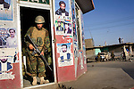 An Afghan National Army soldier looks out from a building in the middle of a main square in the city of Kandahar, Afghanistan, Aug. 19, 2009. The Afghan National Police and Army stepped up their presence in the city ahead of the Aug. 20 presidential election.