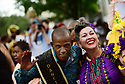 Members of the Baby Doll Sisterhood second line in memory of Baby Doll Tee Eva Perry, who died at 83 on June 7, in New Orleans, La. Monday, June 11, 2018. Darryl Dancing Man Young and Anita Matamoros Oubre