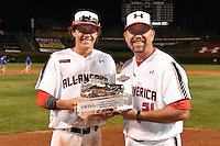 Ryan Mountcastle (5) of Paul J. Hagerty High School in Winter Springs, Florida is awarded the team MVP by Sean Casey (21) after the Under Armour All-American Game on August 16, 2014 at Wrigley Field in Chicago, Illinois.  (Mike Janes/Four Seam Images)