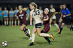 Hannah Betfort (33) of the Wake Forest Demon Deacons keeps the ball away from Luciana Zullo (5) during second half action at Spry Soccer Stadium on August 24, 2017 in Winston-Salem, North Carolina.  The Demon Deacons defeated the Gamecocks 3-2.  (Brian Westerholt/Sports On Film)