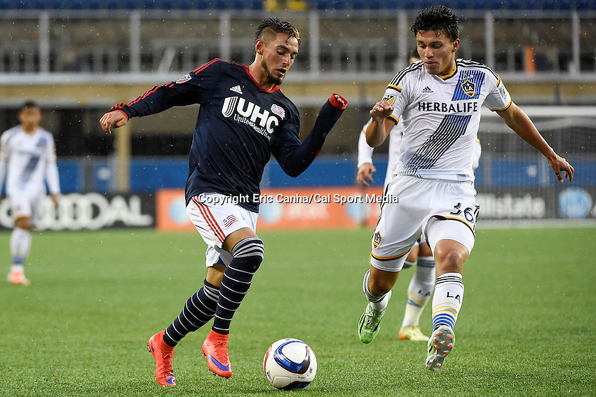 May 31, 2015 - Foxborough, Massachusetts, U.S. - New England Revolution forward Diego Fagundez (14) and Los Angeles Galaxy defender Oscar Sorto (36) chase the ball  during the MLS game between Los Angeles Galaxy and the New England Revolution held at Gillette Stadium in Foxborough Massachusetts. Revolution tied Galaxy 2-2.  Eric Canha/CSM