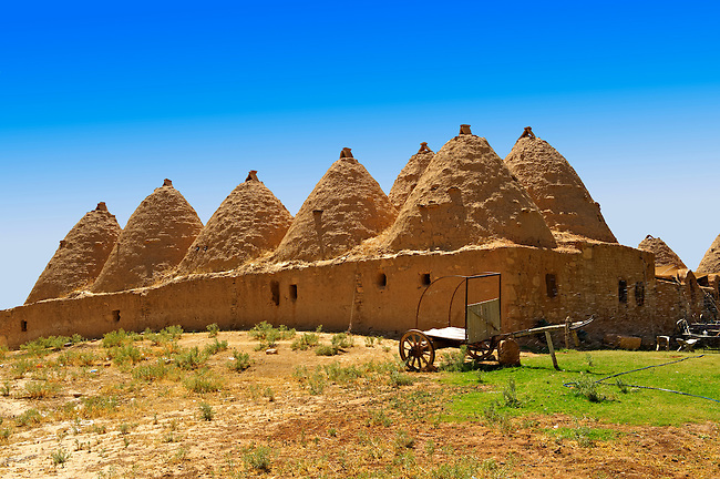 """Pictures of the beehive adobe buildings of Harran, south west Anatolia, Turkey.  Harran was a major ancient city in Upper Mesopotamia whose site is near the modern village of Altınbaşak, Turkey, 24 miles (44 kilometers) southeast of Şanlıurfa. The location is in a district of Şanlıurfa Province that is also named """"Harran"""". Harran is famous for its traditional 'beehive' adobe houses, constructed entirely without wood. The design of these makes them cool inside. 36"""