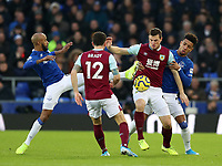 26th December 2019; Goodison Park, Liverpool, Merseyside, England; English Premier League Football, Everton versus Burnley; Fabian Delph and Mason Holgate of Everton compete for the ball with Chris Wood and Robbie Brady of Burnley - Strictly Editorial Use Only. No use with unauthorized audio, video, data, fixture lists, club/league logos or 'live' services. Online in-match use limited to 120 images, no video emulation. No use in betting, games or single club/league/player publications