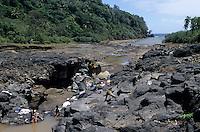 Women washing their clothes in a stream, Sulphur Bay, Tanna Island, Vanuatu