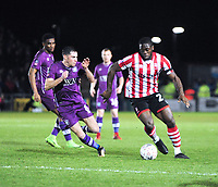 Lincoln City's John Akinde battles with Carlisle United's Mike Jones<br /> <br /> Photographer Andrew Vaughan/CameraSport<br /> <br /> The Emirates FA Cup Second Round - Lincoln City v Carlisle United - Saturday 1st December 2018 - Sincil Bank - Lincoln<br />  <br /> World Copyright © 2018 CameraSport. All rights reserved. 43 Linden Ave. Countesthorpe. Leicester. England. LE8 5PG - Tel: +44 (0) 116 277 4147 - admin@camerasport.com - www.camerasport.com