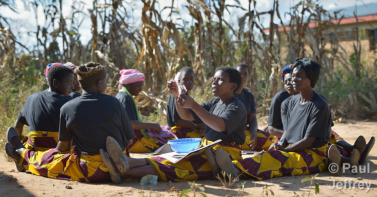 A women's savings group meets in Kaluhoro, Malawi. With support from the Building Sustainable Livelihoods project of the Ekwendeni Hospital AIDS Program, participants are working together to earn and save money, raise more nutritious food, and receive vocational training.