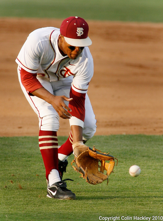 TALLAHASSEE, FL 5/14/10-FSU-NC STATE BASE10 CH-Florida State's Sherman Johnson fields a grounder against N.C. State Friday at Dick Howser Stadium in Tallahassee. The Wolfpack downed the Seminoles 5-2...COLIN HACKLEY PHOTO