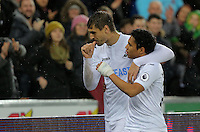 (L-R) Fernando Llorente of Swansea City celebrates his second goal with Jefferson Montero during the Premier League match between Swansea City and Sunderland at The Liberty Stadium, Swansea, Wales, UK. Saturday 10 December 2016