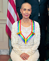 Carmen de Lavallade, one of he five recipients of the 40th Annual Kennedy Center Honors with his award as he poses for a group photo following a dinner hosted by United States Secretary of State Rex Tillerson in their honor at the US Department of State in Washington, D.C. on Saturday, December 2, 2017. The 2017 honorees are: American dancer and choreographer Carmen de Lavallade; Cuban American singer-songwriter and actress Gloria Estefan; American hip hop artist and entertainment icon LL COOL J; American television writer and producer Norman Lear; and American musician and record producer Lionel Richie. Photo Credit: Ron Sachs/CNP/AdMedia