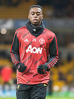 4th January 2020; Molineux Stadium, Wolverhampton, West Midlands, England; English FA Cup Football, Wolverhampton Wanderers versus Manchester United; Aaron Wan Bissaka of Manchester United warming up before the match - Strictly Editorial Use Only. No use with unauthorized audio, video, data, fixture lists, club/league logos or 'live' services. Online in-match use limited to 120 images, no video emulation. No use in betting, games or single club/league/player publications
