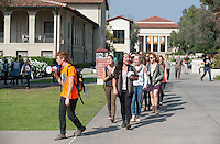 Carson Lambert '17 leads as Occidental College students march in a rally organized by Fossil Free Occidental on Nov. 14, 2014. The group hopes to end Oxy's reliance on fossil fuels by freezing all investments in the 200 largest fossil-fuel companies (measured by their proven carbon reserves in oil, gas or coal) and over the next five to ten years sell the stock in these same companies, and then reinvest 5%, at minimum, of the divested portfolio in socially responsible investments. (Photo by Marc Campos, Occidental College Photographer)