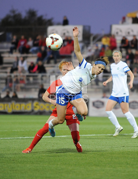 Boyds MD - April 19, 2014: Erika Tymrak (15) of FC Kansas City gets fouled by Tori Huster (23) of the Washington Spirit. The Washington Spirit defeated the FC Kansas City 3-1 during a regular game of the 2014 season of the National Women's Soccer League at the Maryland SoccerPlex.