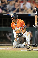 Auburn Tigers shortstop Will Holland (17) celebrates scoring a run in the 8th inning of Game 4 of the NCAA College World Series against the Mississippi State Bulldogs on June 16, 2019 at TD Ameritrade Park in Omaha, Nebraska. Mississippi State defeated Auburn 5-4. (Andrew Woolley/Four Seam Images)