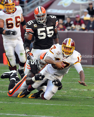 Landover, MD - October 19, 2008 -- Washington Redskins quarterback Jason Campbell (17) is tackled by Cleveland Browns linebacker Kamerion Wimbley (95) to conclude a second quarter scramble at FedEx Field in Landover, Maryland on Sunday, October 19, 2008.  The Redskins won the game 14 - 11..Credit: Ron Sachs / CNP