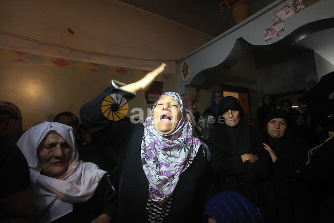 Palestinian women grieve during the funeral of Matar Abu Ata, 20, killed in an Israeli airstrike overnight, in Gaza City, Sunday, Nov. 11, 2012. While cross-border fighting is a common occurrence, hostilities spiraled sharply over the weekend, with bombardments from Gaza causing rare Israeli casualties and Israeli strikes killing at least six Palestinians. Photo by Ashraf Amra