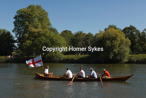 River Thames amateur rowing club  flying the St Georges flag. Surrey England.