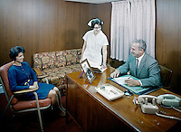Jack Rees Nursing Home, Administrator & nurse speaking to a woman in an office.