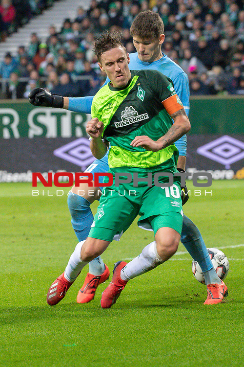 10.02.2019, Weser Stadion, Bremen, GER, 1.FBL, Werder Bremen vs FC Augsburg, <br /> <br /> DFL REGULATIONS PROHIBIT ANY USE OF PHOTOGRAPHS AS IMAGE SEQUENCES AND/OR QUASI-VIDEO.<br /> <br />  im Bild<br /> <br /> fair play <br /> Max Kruse (Werder Bremen #10) sagt kein foul von Gregor Kobel (FC Augsburg #40)<br /> <br /> Foto &copy; nordphoto / Kokenge