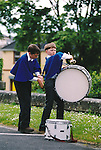 Getting it right for the start of the Fleadh Nua parade in Ennis - June 4, 1999. Photograph by John Kelly
