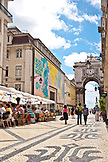 PORTUGAL, Lisbon, Pedestrians walking and dining in Rua Augusta, Baixa area. View of Museu Design Moda in the background