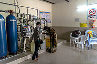 Padmaja, Safe Water Network iJal station operator, right, checks the facility in Rangsaipet, in Waragal, Telangana, Indiia, on Saturday, February 9, 2019. Photographer: Suzanne Lee for Safe Water Network