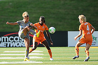 Lianne Sanderson (10) of the Philadelphia Independence plays the ball as India Trotter (20) of Sky Blue FC watches. The Philadelphia Independence defeated Sky Blue FC 2-1 during a Women's Professional Soccer (WPS) match at John A. Farrell Stadium in West Chester, PA, on June 6, 2010.