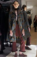 Model in Look 18: Jacquard Coat, Haunted Wallpaper Top, Burgundy Solid Suiting Pant