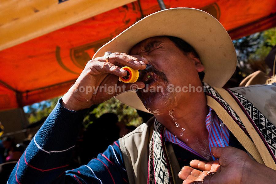 A Peruvian peasant drinks liquor during the Yawar Fiesta, a ritual fight between the condor and the bull, held in the mountains of Apurímac, Cotabambas, Peru, 30 July 2012. The Yawar Fiesta (Feast of Blood), an indigenous tradition which dates back to the time of the conquest, consists basically of an extraordinary bullfight in which three protagonists take part - a wild condor, a wild bull and brave young men of the neighboring communities. The captured condor, a sacred bird venerated by the Indians, is tied in the back of the bull which is carefully selected for its strength and pugnacity. A condor symbolizes the native inhabitants of the Andes, while a bull symbolically represents the Spanish invaders. Young boys, chasing the fighting animals, wish to show their courage in front of the community. However, the Indians usually do not allow the animals to fight for a long time because death or harm of the condor is interpreted as a sign of misfortune to the community.