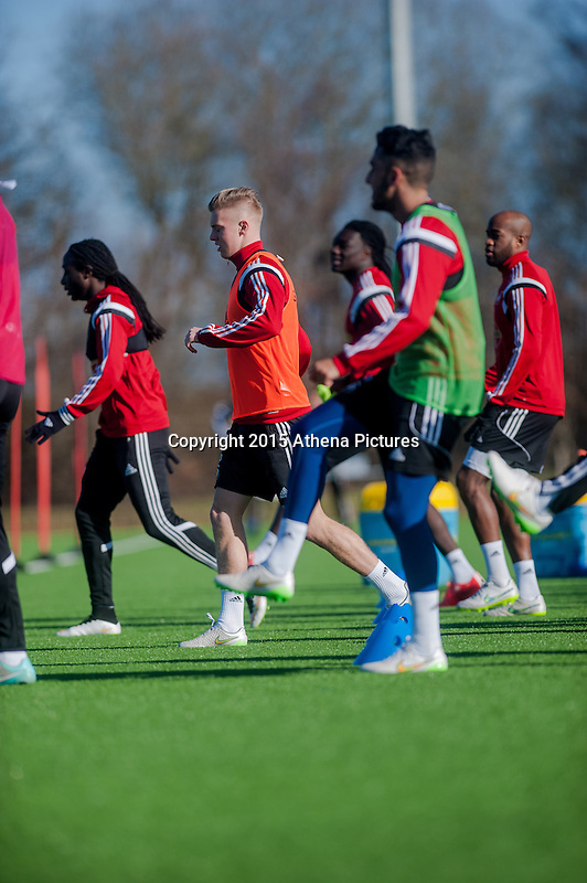 SWANSEA, WALES - FEBRUARY 17: Swansea City squad members in action during a training session at the Fairwood training ground on February 17, 2015 in Swansea, Wales.  (Photo by Athena Pictures )