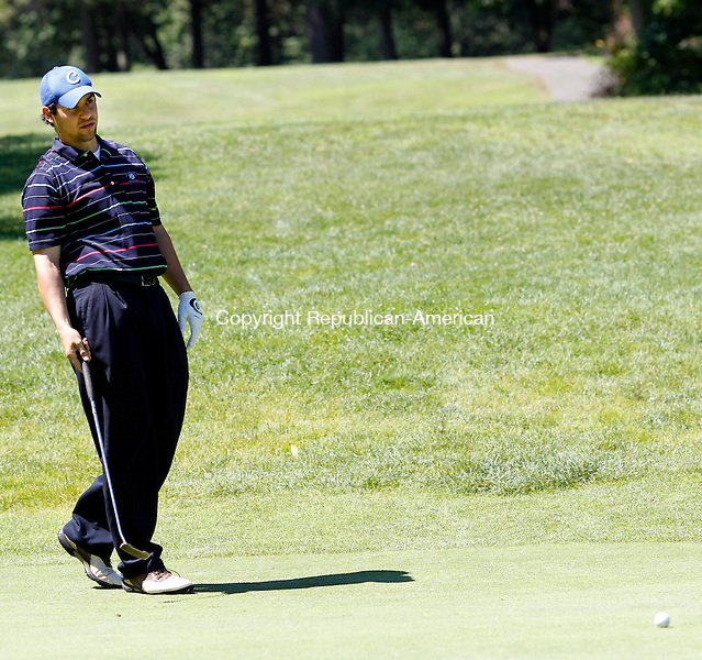 Waterbury, CT- 17, July 2011-071711CM07 Runner up, Tommy Dorso Jr. watches his put on the 4th green during the Mayor's Cup held at East Mountain Golf Course Sunday morning in Waterbury.  Christopher Massa Republican-American