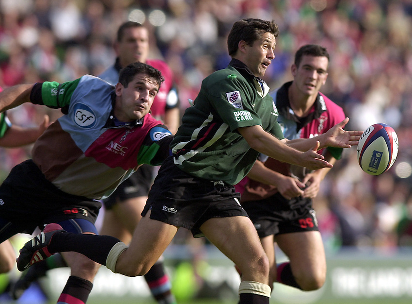 Photo. Richard Lane.NEC Harlequins v London Irish. Zurich Premiership. 21-09-2002.Barry Everitt  gets the ball away as Nick Greenstock tackles.