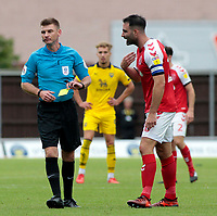 Fleetwood Town's Craig Morgan argues his case with Referee Ollie Yates<br /> <br /> Photographer David Shipman/CameraSport<br /> <br /> The EFL Sky Bet League One - Oxford United v Fleetwood Town - Saturday August 11th 2018 - Kassam Stadium - Oxford<br /> <br /> World Copyright &copy; 2018 CameraSport. All rights reserved. 43 Linden Ave. Countesthorpe. Leicester. England. LE8 5PG - Tel: +44 (0) 116 277 4147 - admin@camerasport.com - www.camerasport.com