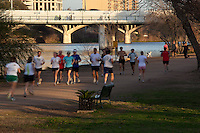 Runners, joggers, and walkers all make the Lady Bird Lake Hike and Bike Trail the popular place to walk, run, bike and exercise in Austin, Texas
