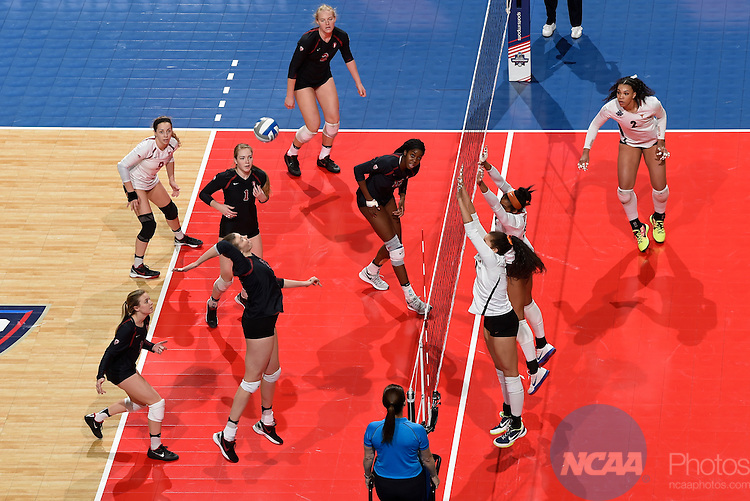 COLUMBUS, OH - DECEMBER 17:  Merete Lutz (17) of Stanford University attempts a kill against the University of Texas during the Division I Women's Volleyball Championship held at Nationwide Arena on December 17, 2016 in Columbus, Ohio.  Stanford defeated Texas 3-1 to win the national title. (Photo by Jamie Schwaberow/NCAA Photos via Getty Images)