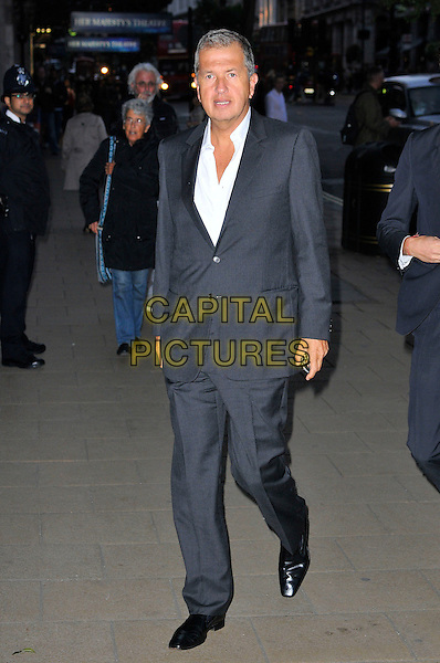 Mario Testino.Wool Modern private view, La Galleria, Royal Opera Arcade, London, England..September 7th, 2011.full length grey gray suit white shirt.CAP/CAS.©Bob Cass/Capital Pictures.
