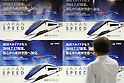 July 17, 2010 - Tokyo, Japan - A commuter takes photo of a poster for the new Skyliner's indigo blue and white exterior created by Fashion designer Kansai Yamamoto, at Ueno station in Tokyo, Japan, on July 17, 2010. The new high-speed railway line was launched that day linking Nippori Station and Airport Terminal 2 Station in 36 minutes, 15 minutes faster than on the old Skyliner.