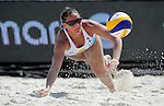 ST. PETERSBURG, FL - JUNE 18: Georgina Klug of Argentina dives and digs the ball out of the sand during the FIVB Beach Volleyball World Tour St. Petersburg Grand Slam presented by the AVP on June 18, 2015 at Spa Beach in St. Petersburg, Florida. (Photo by Donald Miralle for the AVP)