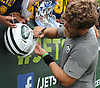 Ryan Fitzpatrick #14, New York Jets starting quarterback, signs autographs for fans after a day of team training camp at Atlantic Health Jets Training Center in Florham Park, NJ on Tuesday, Aug. 2, 2016.