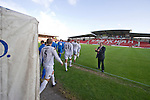 Bangor City 0 FC Honka 1, 23/07/2009. Racecourse Ground, Europa League. The players walking onto the pitch before Bangor City's Europa League second round second leg tie against FC Honka (in white) from Finland at Wrexham's Racecourse Ground. The match had to be staged away from City's Farrar Road ground as it did not meet UEFA's stadium standards. The Finns won 1-0 in Wales to go through 3-0 on aggregate in front of 602 spectators in the first season of the newly-introduced competition which replaced the UEFA Cup. Photo by Colin McPherson.