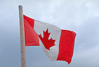 Canadian flag blowing in the wind. Danbury Wisconsin USA